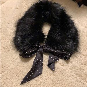 Faux fur collar with polka dot tie.